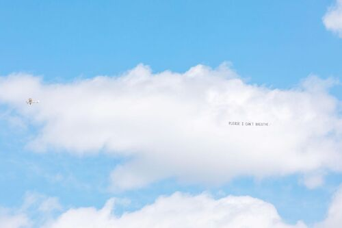 Artist Jammie Holmes flew banners over five U.S. cities featuring George Floyd's final words.