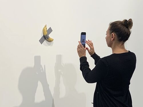 The buyers of two editions of Maurizio Cattelan's banana artwork were revealed.