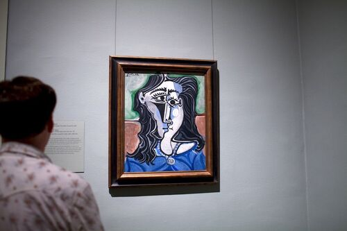 A U.S. judge struck down a French court's $2.2-ruling in a copyright dispute over Picasso photos.