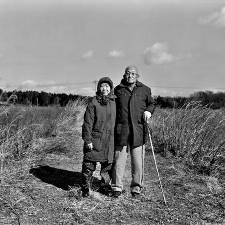 Ai Iwane, 'Tomioka, Fukushima —Farmers Taisuke and Itsuko Saito standing in their rice field'