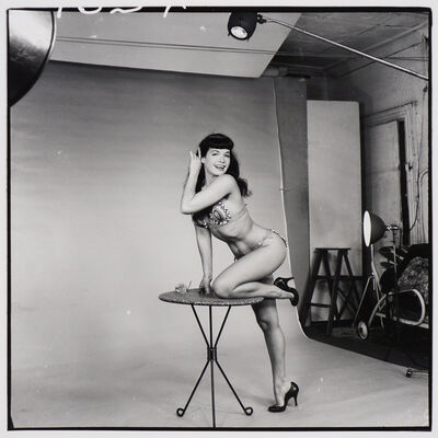 Weegee, 'Bettie Page (on three-legged table)', ca. 1955/1980s