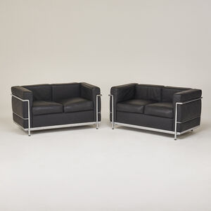 Style of Le Corbusier, 'Pair of Petit Confort loveseats, retailed by DWR', 2004
