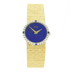 Piaget, '18ct yellow gold lapis dial ladies bracelet watch by Piaget with diamond and sapphire set bezel.', ca. 1970