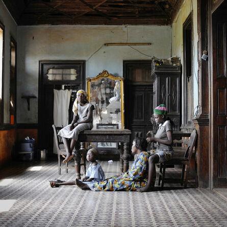 Nicola Lo Calzo, 'Conforte with Godonou family in the living room of their house, Porto Novo, Benin.', 2011