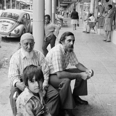 David Goldblatt, 'Golam Mehmood Mia (left), Mehmood Mia (right), and Iqbal Abdullah on 14th Street, Fietas before the destruction of the businesses under the Group Areas Act. Jan 1976', 1976