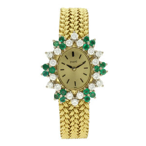 Piaget, '18ct yellow gold and diamond and emerald set bracelet watch.', ca. 1970