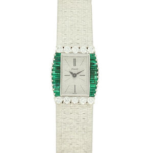 Piaget, '18ct white gold bracelet watch with diamond and emerald bezel.', ca. 1970