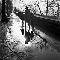 Vivian Maier, '1241, Father and children rollerskating on sidewalk', 2012