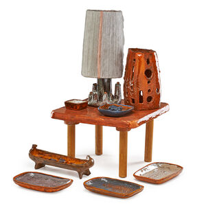 Juliette Derel, 'Nine pieces with impressed and applied decoration: child's table, sculptural table lamp, candle shade, footed gondola vessel, three platters, candleholder, and ring dish'
