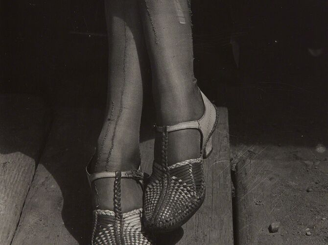 Mended Stockings by Dorothea Lange