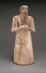 Standing male worshiper