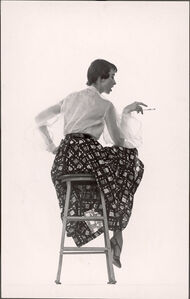 Model Dorian Leigh Wearing White Organdy Shirt with Full Print Skirt by Ceil Chapman (face seen in profile)