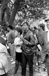 Black Panther couple listening, Free Huey Rally, De Fremery Park, Oakland, CA