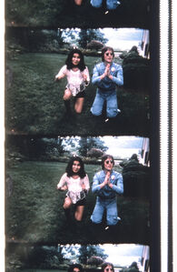 John & Yoko Posing for a Polaroid to be delivered to George Maciunas