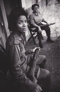 Building managers, Havana - Woman with a machine gun, Havana (Cuba series)