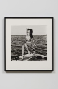 Bettie Page on Chris Craft with Hand Behind the Head