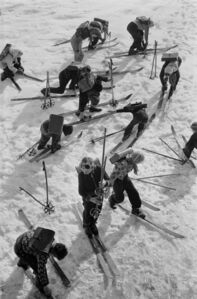 Children in the Austrian Enns valley scrambling to get their skis off