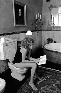 Girl Reading in Bathroom, Milan, Italy