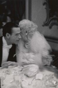 Elderly woman whispering to her dinner partner, Grand Opera Ball, N.Y.C.