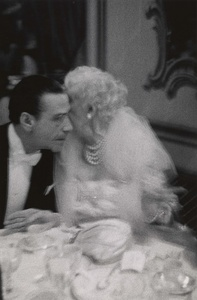 Elderly woman whispering to her dinner partner, Grand Opera Ball, N.Y.C.
