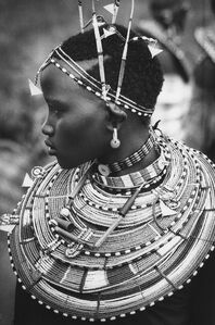 A young girl of the Masai dressed in beaded finery for a circumcision ceremony, Kenya
