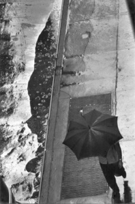 Man with Umbrella, Rain Puddle, from Above, 11 West 22nd Street, NYC
