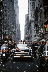 John F Kennedy and Jacqueline Kennedy at a parade in New York.