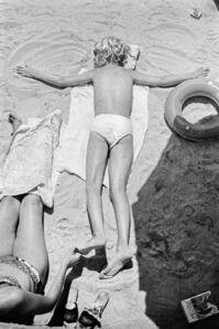 Sunning on the sandy beach. Cannes, France.