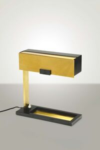 A table lamp with a brass and lacquered metal structure