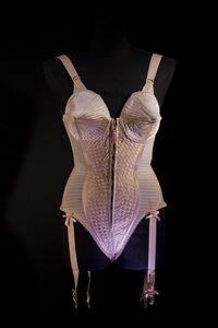 "Corset-style body suit with garters, worn by Madonna during the ""Metropolis"" (""Express Yourself"") sequence of the Blond Ambition World Tour"