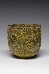 Vessel with green crater glazes