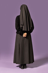 Nun With Hands Behind Her Back