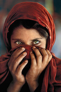 Afghan girl hiding face