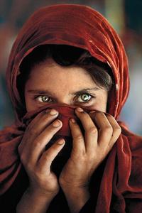 Afghan girl hiding face