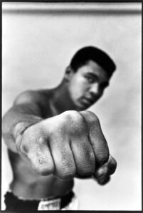 Heavy weight champion Muhammad Ali showing off his right fist.