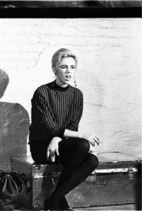 Edie Sedgwick on Billy's silver trunk on the set of Prison