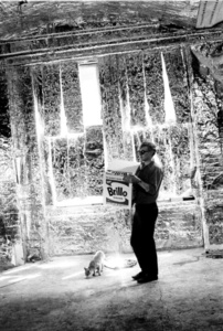 Andy Warhol carries Brillo Box Sculpture with Ruby the cat