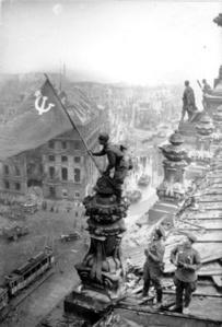 Rasing a flag over the Reichstag