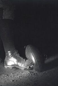 Wes Fessler kicking a football