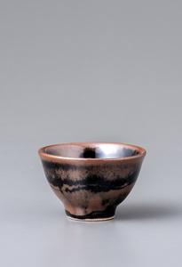 Sake cup, kaki and black glazes with wax resist decoration