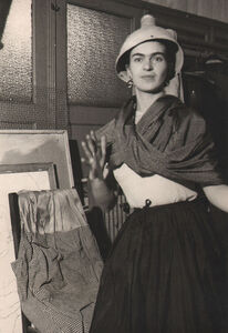 Frida acting clownish with lamp on her head, N.W. School, NYC
