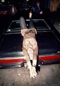 Woman Reclining on Car