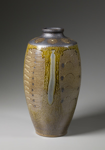 Ten-gallon vase, yellow ash glaze with black slip shoulder and neck, decorative panels, and blue glass runs
