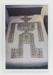 Money robot on bed