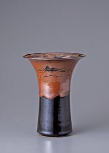 Vase, kaki and black glazes with wax resist decoration
