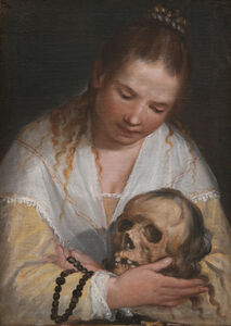 Woman contemplating a skull