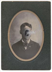untitled (faceless man with large smoking orifice)