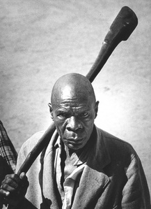 The 'Executioner' of Bunyoro with his symbolic axe, Uganda