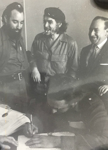 Che Onlooking Fidel Signing Document