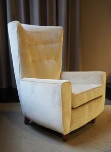 1930's big armchair with white pearl velvet upholstery. Wood feet.